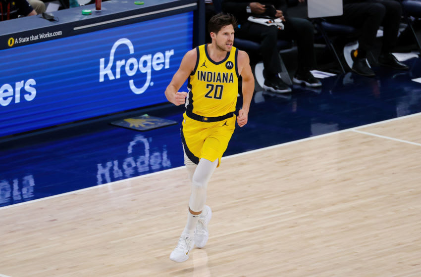 INDIANAPOLIS, INDIANA - APRIL 02: Doug McDermott #20 of the Indiana Pacers reacts in the fourth quarter against the Charlotte Hornets at Bankers Life Fieldhouse on April 02, 2021 in Indianapolis, Indiana. NOTE TO USER: User expressly acknowledges and agrees that, by downloading and or using this photograph, User is consenting to the terms and conditions of the Getty Images License Agreement. (Photo by Dylan Buell/Getty Images)