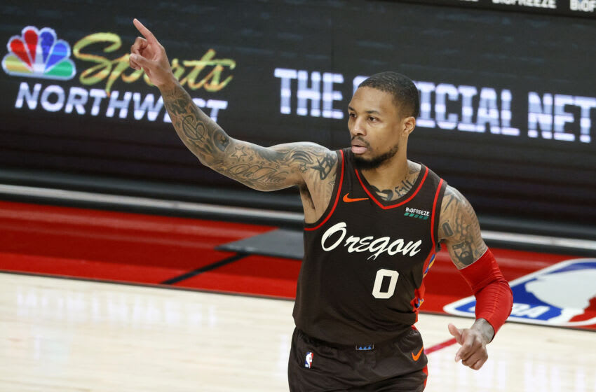 PORTLAND, OREGON - MARCH 18: Damian Lillard #0 of the Portland Trail Blazers reacts after his three point basket against the New Orleans Pelicans during the second quarter at Moda Center on March 18, 2021 in Portland, Oregon. NOTE TO USER: User expressly acknowledges and agrees that, by downloading and or using this photograph, User is consenting to the terms and conditions of the Getty Images License Agreement. (Photo by Steph Chambers/Getty Images)