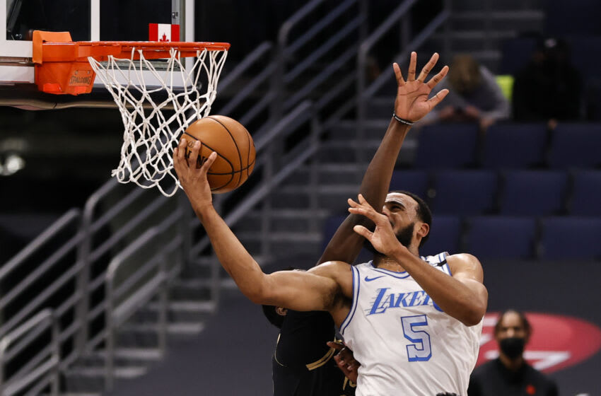 TAMPA, FLORIDA - APRIL 06: Talen Horton-Tucker #5 of the Los Angeles Lakers drives for the net as Chris Boucher #25 of the Toronto Raptors defends during the fourth quarter at Amalie Arena on April 06, 2021 in Tampa, Florida.NOTE TO USER: User expressly acknowledges and agrees that, by downloading and or using this photograph, User is consenting to the terms and conditions of the Getty Images License Agreement. (Photo by Douglas P. DeFelice/Getty Images)