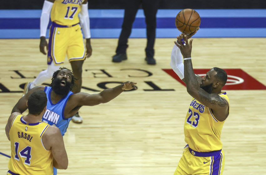 Jan 12, 2021; Houston, Texas, USA; Los Angeles Lakers forward LeBron James (23) shoots the ball against Houston Rockets guard James Harden (13) during the first quarter at Toyota Center. Mandatory Credit: Troy Taormina-USA TODAY Sports