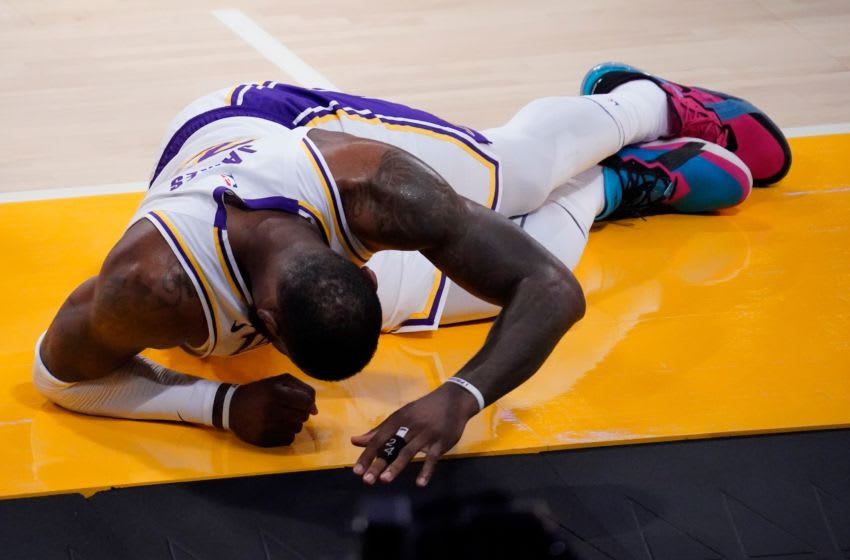Mar 20, 2021; Los Angeles, California, USA; Los Angeles Lakers forward LeBron James (23) on the floor after injuring his leg in a collision for a loose ball during the second quarter against the Atlanta Hawks at Staples Center. Mandatory Credit: Robert Hanashiro-USA TODAY Sports