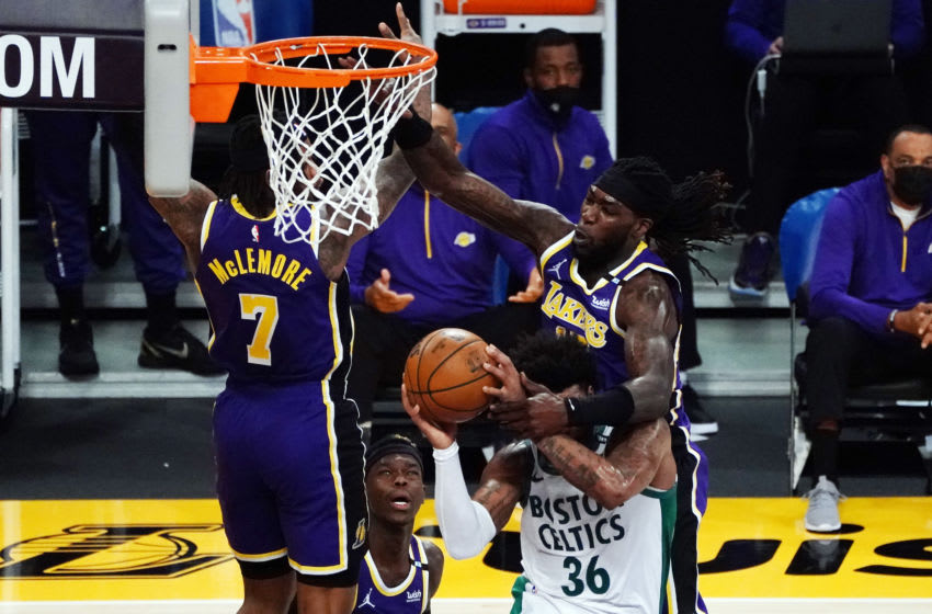 Apr 15, 2021; Los Angeles, California, USA; Boston Celtics guard Marcus Smart (36) loses the ball against the defense of Los Angeles Lakers center Montrezl Harrell (15) during the first half at Staples Center. Mandatory Credit: Gary A. Vasquez-USA TODAY Sports