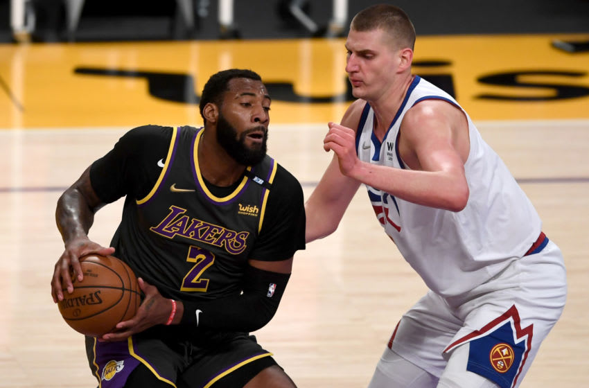 May 3, 2021; Los Angeles, California, USA; Los Angeles Lakers center Andre Drummond (2) is defended by Denver Nuggets center Nikola Jokic (15) in the first quarter of the game at Staples Center. Mandatory Credit: Jayne Kamin-Oncea-USA TODAY Sports