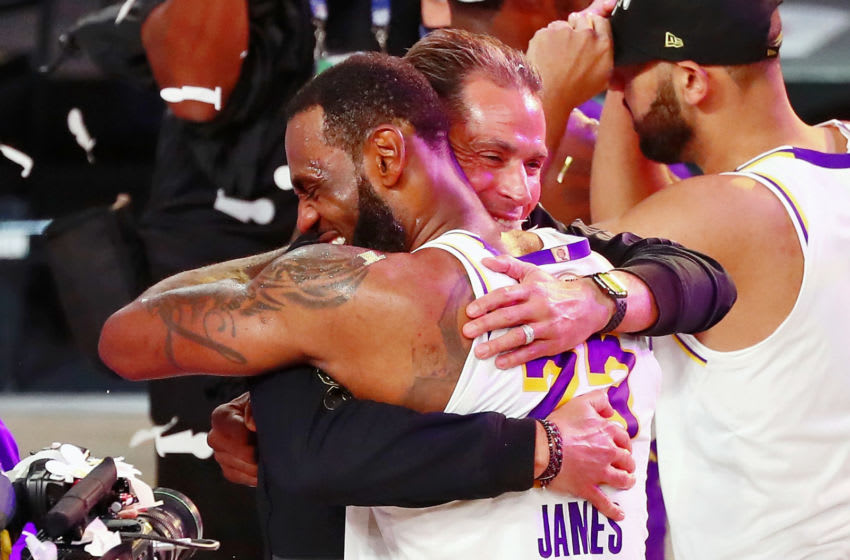 Oct 11, 2020; Lake Buena Vista, Florida, USA; Los Angeles Lakers forward LeBron James (23) hugs general manager Rob Pelinka after game six of the 2020 NBA Finals at AdventHealth Arena. The Los Angeles Lakers won 106-93 to win the series. Mandatory Credit: Kim Klement-USA TODAY Sports