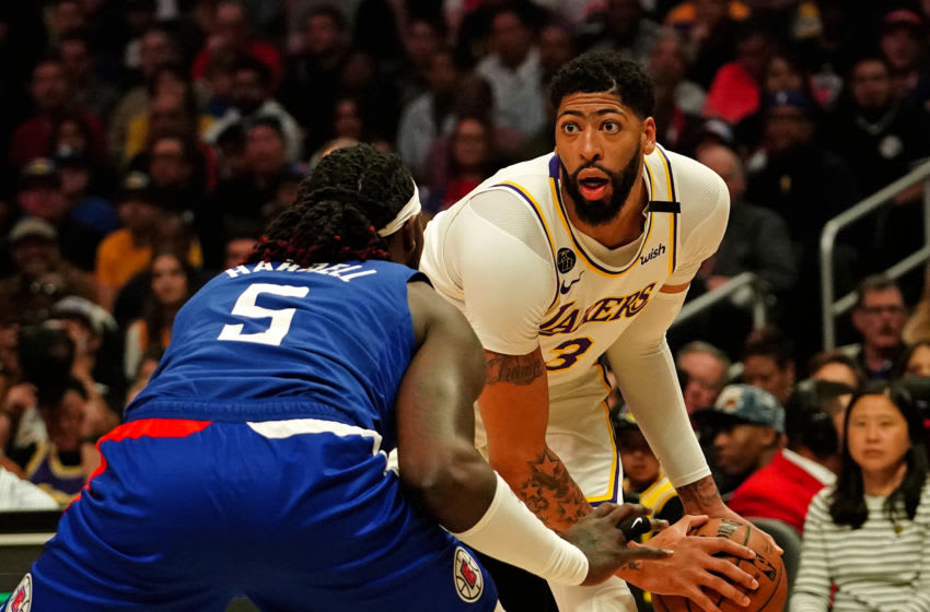 Mar 8, 2020; Los Angeles, California, USA; Los Angeles Lakers forward Anthony Davis (3) is guarded by LA Clippers forward Montrezl Harrell (5) in the first half at Staples Center. Mandatory Credit: Kirby Lee-USA TODAY Sports