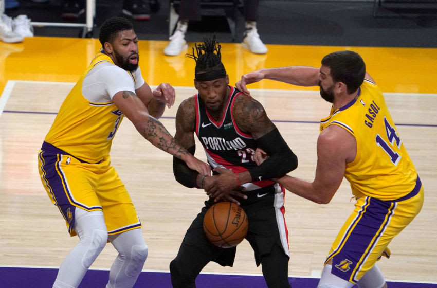 Dec 28, 2020; Los Angeles, California, USA; Portland Trail Blazers forward Robert Covington (23) battles for the ball with Los Angeles Lakers forward Anthony Davis (3) and center Marc Gasol (14) in the first quarter at Staples Center. Mandatory Credit: Kirby Lee-USA TODAY Sports