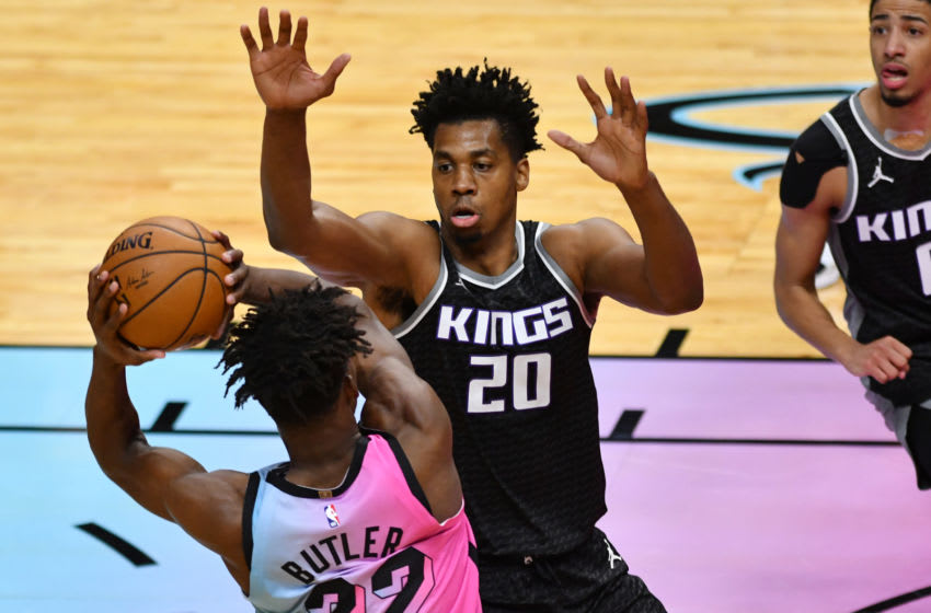 Jan 30, 2021; Miami, Florida, USA; Sacramento Kings center Hassan Whiteside (20) defends Miami Heat forward Jimmy Butler (22) during the fourth quarter at American Airlines Arena. Mandatory Credit: Jim Rassol-USA TODAY Sports