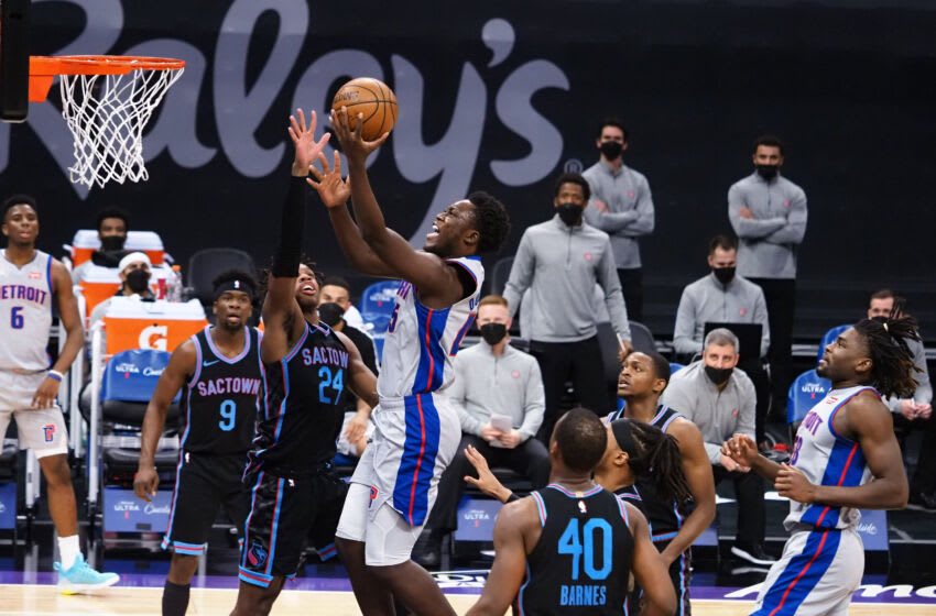 Apr 8, 2021; Sacramento, California, USA; Detroit Pistons forward Sekou Doumbouya (45) goes up for a basket against Sacramento Kings guard Buddy Hield (24) during the second quarter at Golden 1 Center. Mandatory Credit: Kelley L Cox-USA TODAY Sports