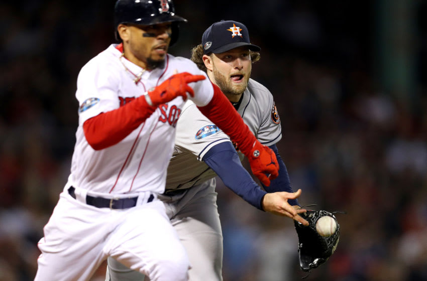 BOSTON, MA - OCTOBER 14: Gerrit Cole #45 of the Houston Astros throws out Mookie Betts #50 of the Boston Red Sox during the fourth inning in Game Two of the American League Championship Series at Fenway Park on October 14, 2018 in Boston, Massachusetts. (Photo by Maddie Meyer/Getty Images)