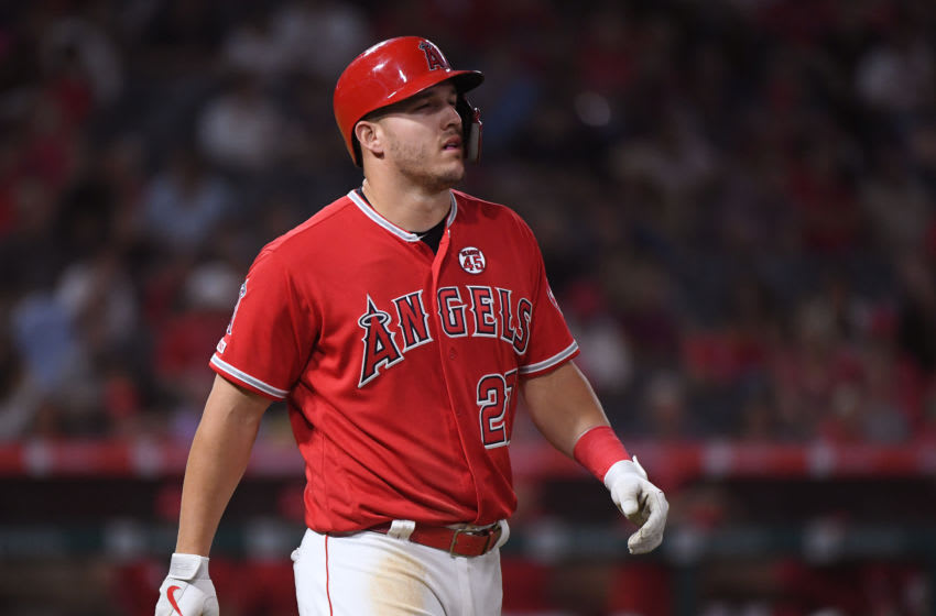 ANAHEIM, CALIFORNIA - JULY 29: Mike Trout #27 of the Los Angeles Angels reacts as he walks to first base after he was hit by a pitch during the sixth inning against the Detroit Tigers at Angel Stadium of Anaheim on July 29, 2019 in Anaheim, California. (Photo by Harry How/Getty Images)