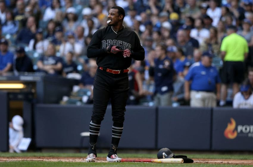MILWAUKEE, WISCONSIN - AUGUST 24: Adam Jones #10 of the Arizona Diamondbacks reacts after striking out in the first inning against the Milwaukee Brewers at Miller Park on August 24, 2019 in Milwaukee, Wisconsin. Teams are wearing special color schemed uniforms with players choosing nicknames to display for Players' Weekend. (Photo by Dylan Buell/Getty Images)