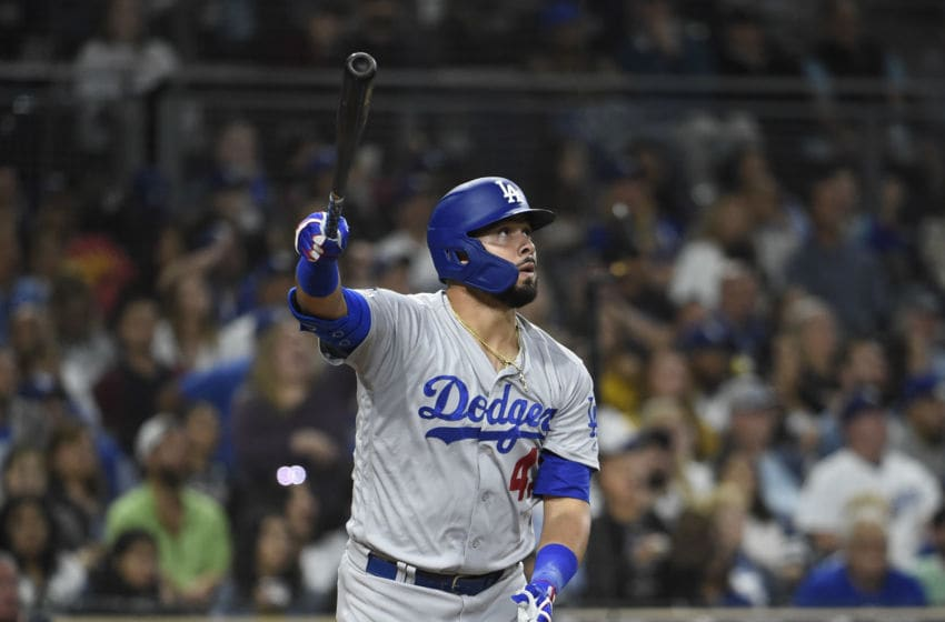 SAN DIEGO, CA - SEPTEMBER 25: Edwin Rios #43 of the Los Angeles Dodgers hits a solo home run during the the seventh inning of a baseball game against the San Diego Padres at Petco Park September 25, 2019 in San Diego, California. (Photo by Denis Poroy/Getty Images)