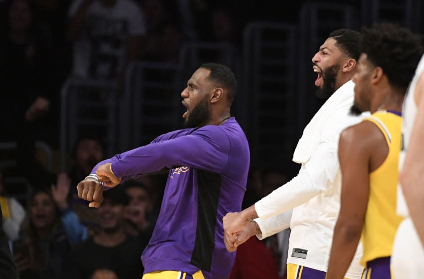 LOS ANGELES, CA - OCTOBER 29: LeBron James #23 and Anthony Davis #3 of the Los Angeles Lakers celebrate after a dunk by JaVale McGee #7 against Memphis Grizzlies during the second half at Staples Center on October 29, 2019 in Los Angeles, California. NOTE TO USER: User expressly acknowledges and agrees that, by downloading and/or using this Photograph, user is consenting to the terms and conditions of the Getty Images License Agreement. (Photo by Kevork Djansezian/Getty Images)