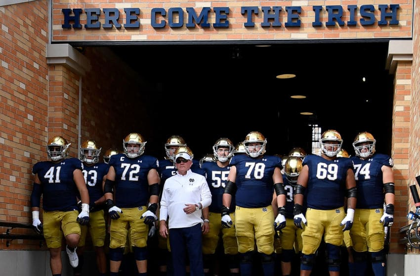 SOUTH BEND, INDIANA - OCTOBER 05: Head coach Brian Kelly and players of the Notre Dame Fighting Irish prepare to take the field for the game against the Bowling Green Falcons at Notre Dame Stadium on October 05, 2019 in South Bend, Indiana. (Photo by Quinn Harris/Getty Images)