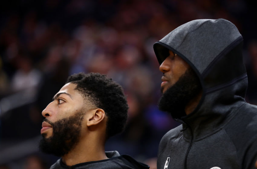 SAN FRANCISCO, CALIFORNIA - OCTOBER 05: Anthony Davis (left) #3 sits next to LeBron James #23 of the Los Angeles Lakers during their game against the Golden State Warriors at Chase Center on October 05, 2019 in San Francisco, California. NOTE TO USER: User expressly acknowledges and agrees that, by downloading and or using this photograph, User is consenting to the terms and conditions of the Getty Images License Agreement. (Photo by Ezra Shaw/Getty Images)