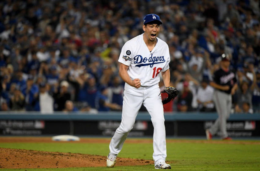 LOS ANGELES, CALIFORNIA - OCTOBER 09: Kenta Maeda #18 of the Los Angeles Dodgers reacts after striking out Yan Gomes #10 of the Washington Nationals in the eighth inning of game five of the National League Division Series at Dodger Stadium on October 09, 2019 in Los Angeles, California. (Photo by Harry How/Getty Images)