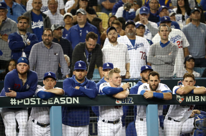 LOS ANGELES, CALIFORNIA - OCTOBER 09: The Los Angeles Dodgers look on from the dug out as they lose to the Washington Nationals 7-3 in ten innings of game five and the National League Division Series at Dodger Stadium on October 09, 2019 in Los Angeles, California. (Photo by Sean M. Haffey/Getty Images)