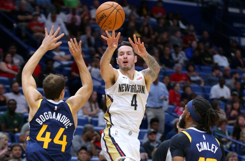 NEW ORLEANS, LOUISIANA - OCTOBER 11: JJ Redick #4 of the New Orleans Pelicans passes around Bojan Bogdanovic #44 of the Utah Jazz during the second half of a game at the Smoothie King Center on October 11, 2019 in New Orleans, Louisiana. (Photo by Jonathan Bachman/Getty Images)