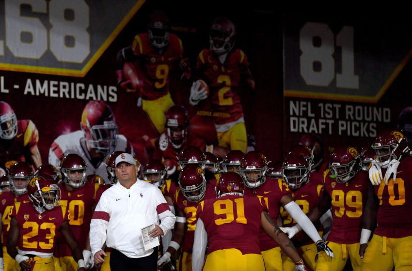 LOS ANGELES, CALIFORNIA - OCTOBER 19: Head coach Clay Helton of the USC Trojans leads his team on to the field before the game against the Arizona Wildcats at Los Angeles Memorial Coliseum on October 19, 2019 in Los Angeles, California. (Photo by Harry How/Getty Images)