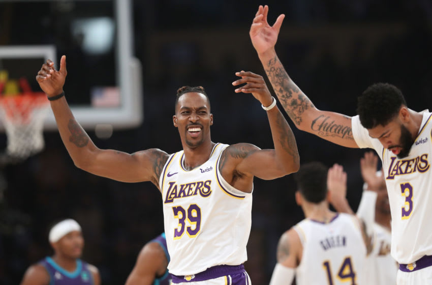 LOS ANGELES, CALIFORNIA - OCTOBER 27: Dwight Howard #39 and Anthony Davis #3 of the Los Angeles Lakers react after scoring during the first half of a game against the Charlotte Hornets at Staples Center on October 27, 2019 in Los Angeles, California. (Photo by Sean M. Haffey/Getty Images)
