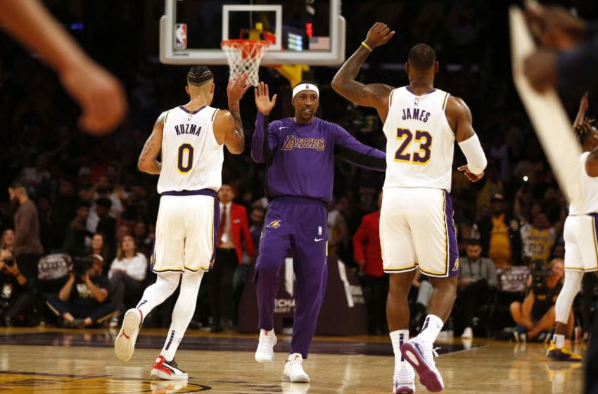 LOS ANGELES, CALIFORNIA - NOVEMBER 17: Kyle Kuzma #0, Kentavious Caldwell-Pope #1 , and LeBron James #23 of the Los Angeles Lakers react during the second half of a game against the Atlanta Hawks at Staples Center on November 17, 2019 in Los Angeles, California. NOTE TO USER: User expressly acknowledges and agrees that, by downloading and or using this photograph, User is consenting to the terms and conditions of the Getty Images License Agreement. (Photo by Katharine Lotze/Getty Images)