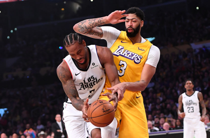 LOS ANGELES, CA - DECEMBER 25: Kawhi Leonard #2 of the Los Angeles Clippers is fouled by Anthony Davis #3 of the Los Angeles Lakers as he drives to the basket in the first half of the game at Staples Center on December 25, 2019 in Los Angeles, California. NOTE TO USER: User expressly acknowledges and agrees that, by downloading and/or using this Photograph, user is consenting to the terms and conditions of the Getty Images License Agreement. (Photo by Jayne Kamin-Oncea/Getty Images)