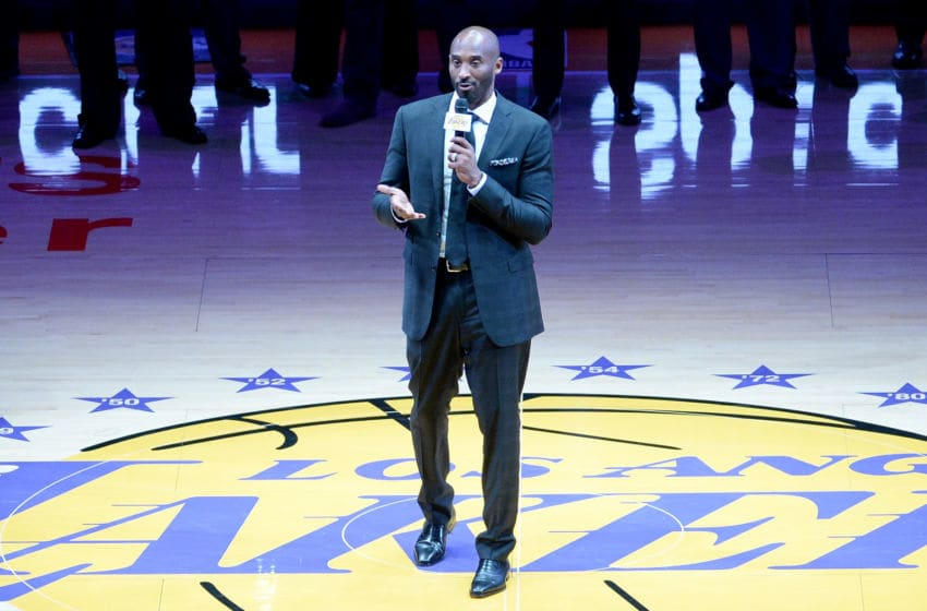 LOS ANGELES, CA - DECEMBER 18: Kobe Bryant addresses the crowd at halftime as both his #8 and #24 Los Angeles Lakers jerseys are retired at Staples Center on December 18, 2017 in Los Angeles, California. NOTE TO USER: User expressly acknowledges and agrees that, by downloading and or using this photograph, User is consenting to the terms and conditions of the Getty Images License Agreement. (Photo by Maxx Wolfson/Getty Images)