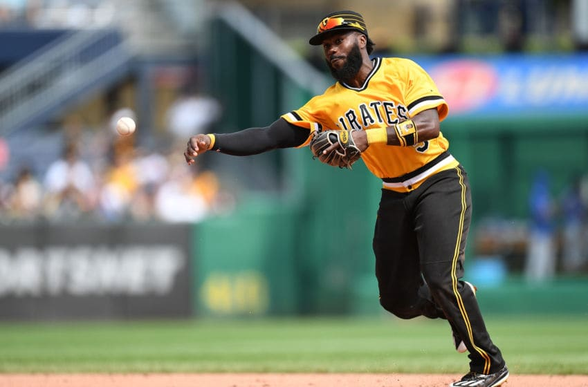 PITTSBURGH, PA - AUGUST 19: Josh Harrison #5 of the Pittsburgh Pirates throws to first base to force out Javier Baez #9 of the Chicago Cubs in the sixth inning during the game at PNC Park on August 19, 2018 in Pittsburgh, Pennsylvania. (Photo by Justin Berl/Getty Images)