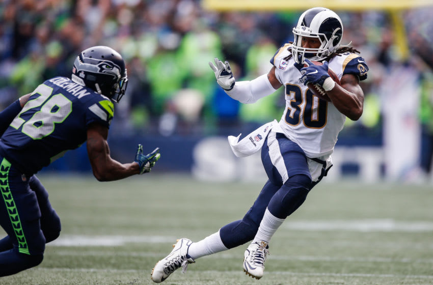 SEATTLE, WA - OCTOBER 07: Running Back Todd Gurley III #30 of the Los Angeles Rams runs the ball in the first half against the Seattle Seahawks at CenturyLink Field on October 7, 2018 in Seattle, Washington. (Photo by Otto Greule Jr/Getty Images)