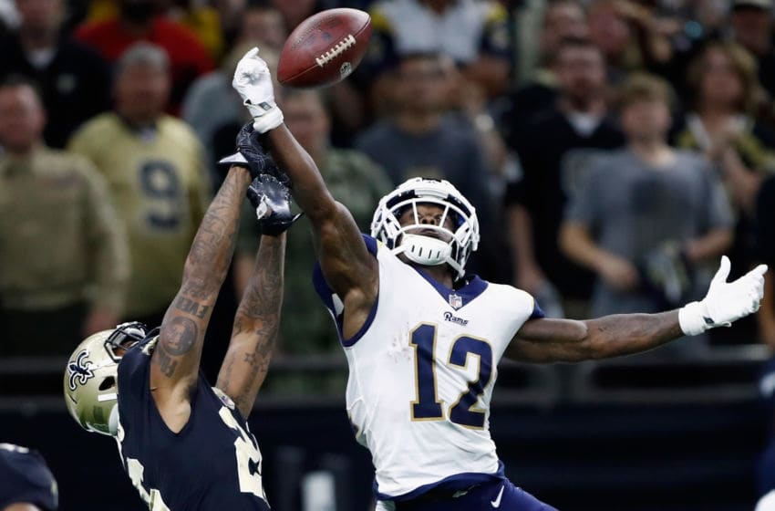 NEW ORLEANS, LA - NOVEMBER 04: P.J. Williams #26 of the New Orleans Saints breaks up the pass meant for Brandin Cooks #12 of the Los Angeles Rams during the fourth quarter of the game at Mercedes-Benz Superdome on November 4, 2018 in New Orleans, Louisiana. The Saints won the game 45-35. (Photo by Wesley Hitt/Getty Images)