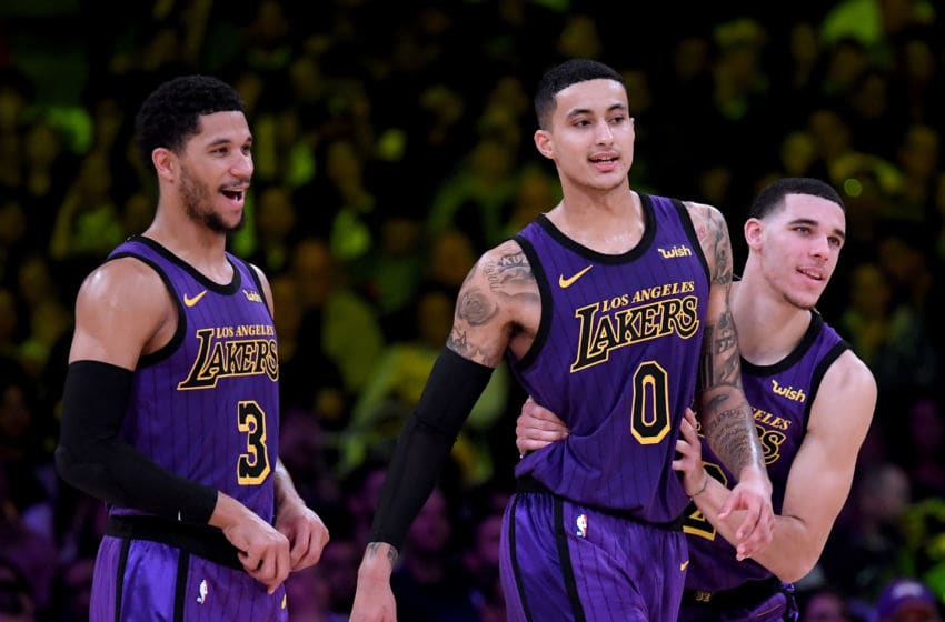 LOS ANGELES, CA - NOVEMBER 30: Lonzo Ball #2, Kyle Kuzma #0 and Josh Hart #3 of the Los Angeles Lakers joke during a 114-103 win over the Dallas Mavericks at Staples Center on November 30, 2018 in Los Angeles, California. NOTE TO USER: User expressly acknowledges and agrees that, by downloading and or using this photograph, User is consenting to the terms and conditions of the Getty Images License Agreement. (Photo by Harry How/Getty Images)