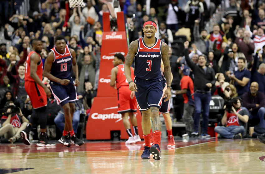 WASHINGTON, DC - JANUARY 13: Bradley Beal #3 of the Washington Wizards celebrates after hitting the game tying shot in regulation against the Toronto Raptors at Capital One Arena on January 13, 2019 in Washington, DC. NOTE TO USER: User expressly acknowledges and agrees that, by downloading and or using this photograph, User is consenting to the terms and conditions of the Getty Images License Agreement. (Photo by Rob Carr/Getty Images)