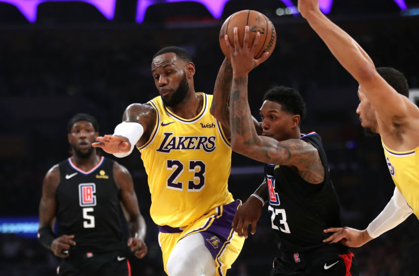 LOS ANGELES, CALIFORNIA - MARCH 04: LeBron James #23 of the Los Angeles Lakers collides with Lou Williams #23 of the Los Angeles Clippers during the first half of a game at Staples Center on March 04, 2019 in Los Angeles, California. (Photo by Sean M. Haffey/Getty Images)