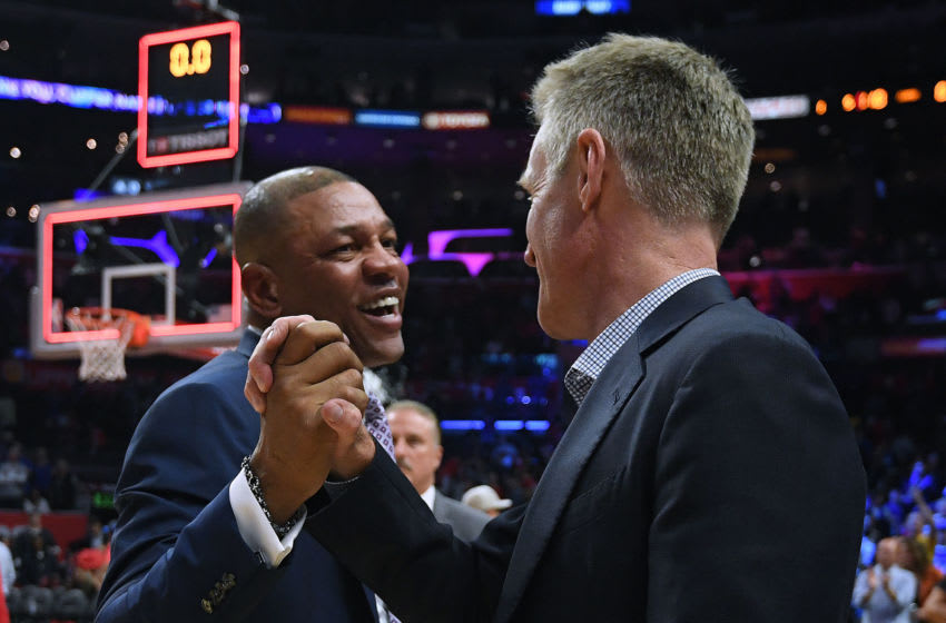 LOS ANGELES, CALIFORNIA - APRIL 26: Doc Rivers of the LA Clippers and Steve Kerr of the Golden State Warriors shake hands in a 129-110 Warrior win during Game Six of Round One of the 2019 NBA Playoffs at Staples Center on April 26, 2019 in Los Angeles, California. (Photo by Harry How/Getty Images) NOTE TO USER: User expressly acknowledges and agrees that, by downloading and or using this photograph, User is consenting to the terms and conditions of the Getty Images License Agreement.