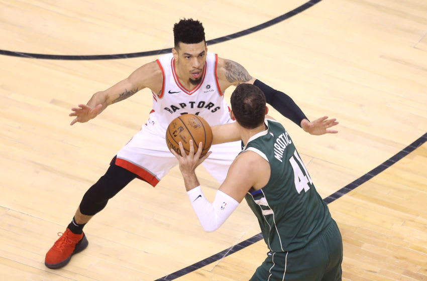 TORONTO, ONTARIO - MAY 21: Danny Green #14 of the Toronto Raptors defends Nikola Mirotic #41 of the Milwaukee Bucks during the first half in game four of the NBA Eastern Conference Finals at Scotiabank Arena on May 21, 2019 in Toronto, Canada. NOTE TO USER: User expressly acknowledges and agrees that, by downloading and or using this photograph, User is consenting to the terms and conditions of the Getty Images License Agreement. (Photo by Claus Andersen/Getty Images)