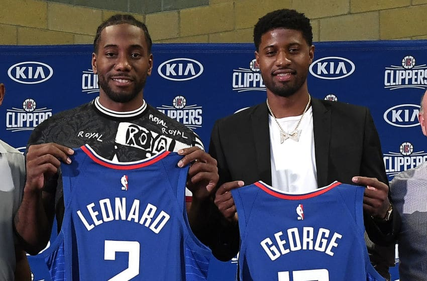 LOS ANGELES, CALIFORNIA - JULY 24: Kawhi Leonard and Paul George of the Los Angeles Clippers are introduced at Green Meadows Recreation Center on July 24, 2019 in Los Angeles, California. NOTE TO USER: User expressly acknowledges and agrees that, by downloading and or using this photograph, User is consenting to the terms and conditions of the Getty Images License Agreement. (Photo by Kevork Djansezian/Getty Images)
