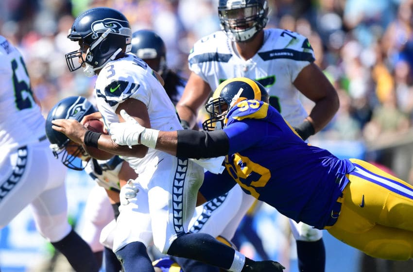 LOS ANGELES, CA - OCTOBER 08: Aaron Donald #99 of the Los Angeles Rams dives to get to Russell Wilson #3 of the Seattle Seahawks during the game at Los Angeles Memorial Coliseum on October 8, 2017 in Los Angeles, California. (Photo by Harry How/Getty Images)