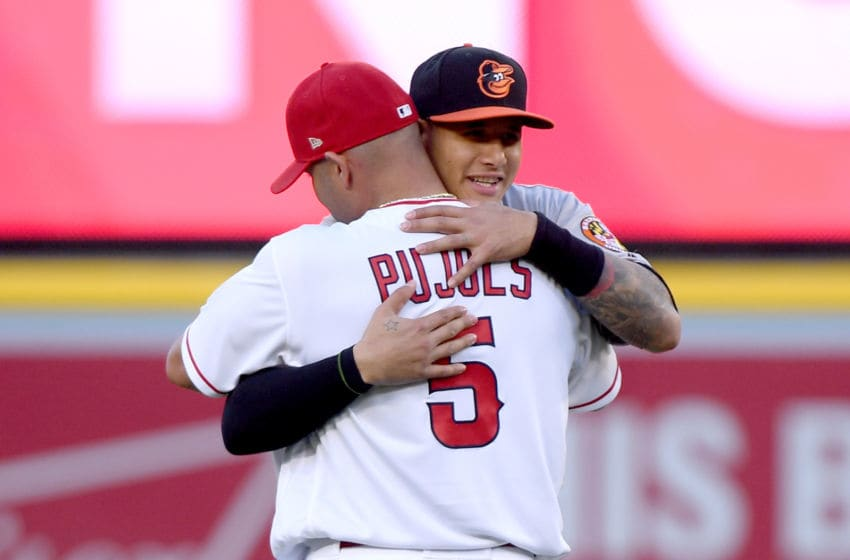 ANAHEIM, CA - MAY 03: Manny Machado #13 of the Baltimore Orioles hugs Albert Pujols #5 of the Los Angeles Angels before the game at Angel Stadium on May 3, 2018 in Anaheim, California. (Photo by Harry How/Getty Images)