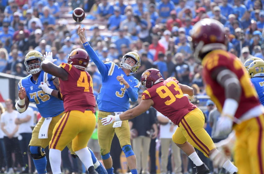 PASADENA, CALIFORNIA - NOVEMBER 17: Wilton Speight #3 of the UCLA Bruins throws a touchdown pass for a 7-0 lead over the USC Trojans during the first quarter at Rose Bowl on November 17, 2018 in Pasadena, California. (Photo by Harry How/Getty Images)