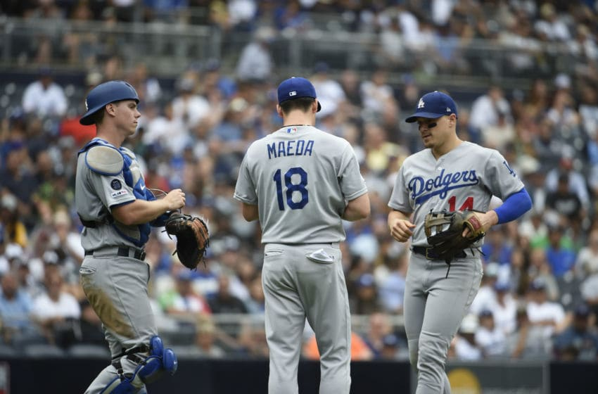 SAN DIEGO, CA - SEPTEMBER 26: Kenta Maeda #18 of the Los Angeles Dodgers, center, talks with Will Smith #16, left, and Enrique Hernandez #14, right, during the the ninth inning of a baseball game against the San Diego Padres at Petco Park September 26, 2019 in San Diego, California. (Photo by Denis Poroy/Getty Images)
