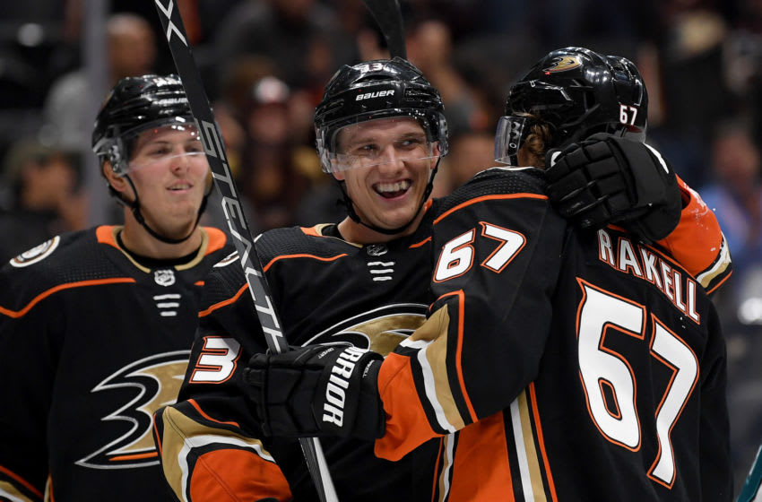 ANAHEIM, CALIFORNIA - SEPTEMBER 24: Jakob Silfverberg #33 of the Anaheim Ducks celebrates his goal with Rickard Rakell #67 and Isac Lundestrom #48 to take a 2-0 lead over the San Jose Sharks during the first period in a preseason game at Honda Center on September 24, 2019 in Anaheim, California. (Photo by Harry How/Getty Images)