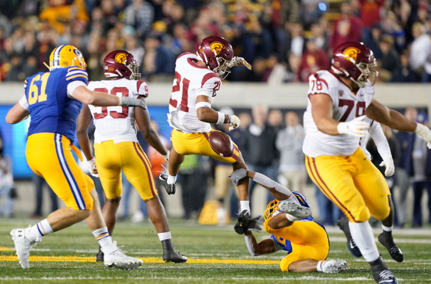 BERKELEY, CALIFORNIA - NOVEMBER 16: Isaiah Pola-Mao #21 of the USC Trojans gets stripped of the ball by DeShawn Collins #26 of the California Golden Bears during the third quarter of an NCAA football game at California Memorial Stadium on November 16, 2019 in Berkeley, California. (Photo by Thearon W. Henderson/Getty Images)