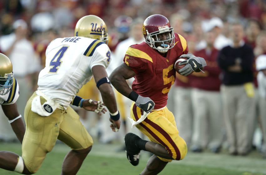 LOS ANGELES, CA - DECEMBER 3: Reggie Bush #5 of the USC Trojans in action against the UCLA Bruins at Los Angeles Memorial Coliseum on December 3, 2005 in Los Angeles, California. USC defeated UCLA 66-19. (Photo by Joe Robbins/Getty Images)