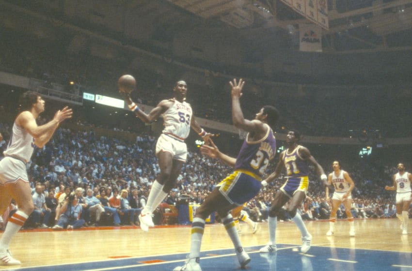 PHILADELPHIA, PA - CIRCA 1980: Darryl Dawkins #53 of the Philadelphia 76ers goes up to shoot over Magic Johnson #32 of the Los Angeles Lakers during an NBA basketball game circa 1980 at The Spectrum in Philadelphia, Pennsylvania. Dawkins played for the 76ers from 1975-82. (Photo by Focus on Sport/Getty Images)