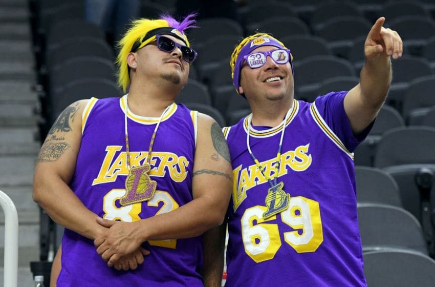 LAS VEGAS, NV - OCTOBER 13: Los Angeles Lakers fans Gordon Runs After (L) of South Dakota and Jerome