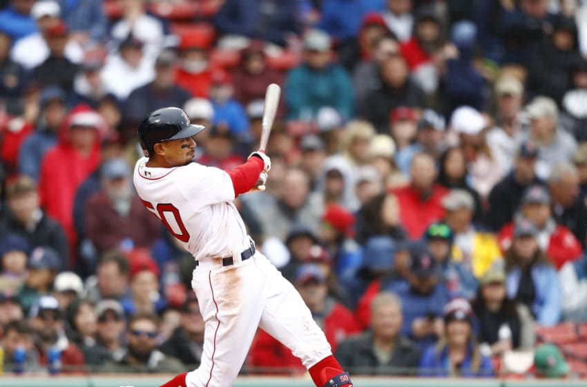 BOSTON, MASSACHUSETTS - APRIL 28: Mookie Betts #50 of the Boston Red Sox hits a double in the bottom of the sixth inning of the game against the Tampa Bay Rays at Fenway Park on April 28, 2019 in Boston, Massachusetts. (Photo by Omar Rawlings/Getty Images)