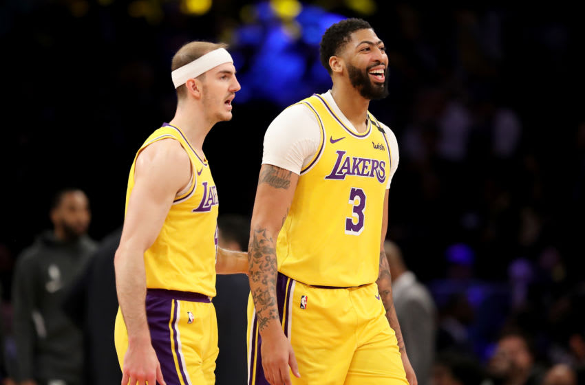 NEW YORK, NEW YORK - JANUARY 22: Alex Caruso #4 and Anthony Davis #3 of the Los Angeles Lakers celebrate late in the fourth quarter against the New York Knicks at Madison Square Garden on January 22, 2020 in New York City.NOTE TO USER: User expressly acknowledges and agrees that, by downloading and or using this photograph, User is consenting to the terms and conditions of the Getty Images License Agreement. (Photo by Elsa/Getty Images)