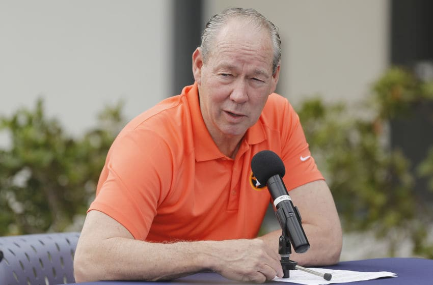 WEST PALM BEACH, FLORIDA - FEBRUARY 13: Owner Jim Crane of the Houston Astros reads a prepared statement during a press conference at FITTEAM Ballpark of The Palm Beaches on February 13, 2020 in West Palm Beach, Florida. (Photo by Michael Reaves/Getty Images)