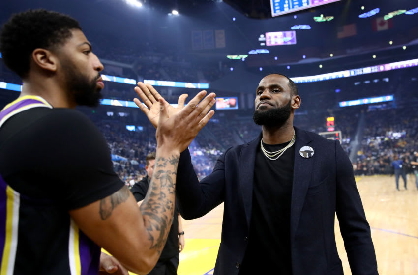 SAN FRANCISCO, CALIFORNIA - FEBRUARY 27: LeBron James #23 high fives Anthony Davis #3 of the Los Angeles Lakers before their game against the Golden State Warriorsat Chase Center on February 27, 2020 in San Francisco, California. NOTE TO USER: User expressly acknowledges and agrees that, by downloading and or using this photograph, User is consenting to the terms and conditions of the Getty Images License Agreement. (Photo by Ezra Shaw/Getty Images)