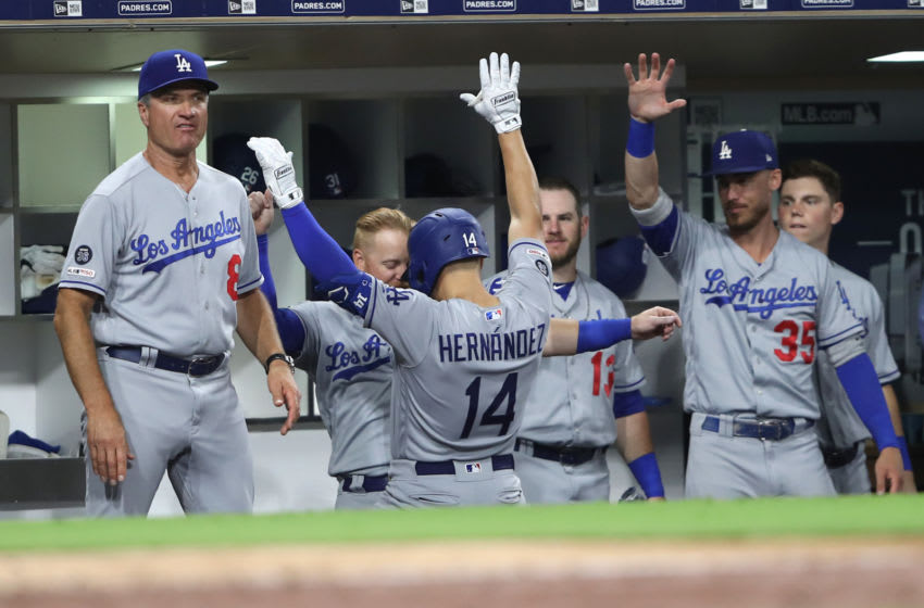 SAN DIEGO, CALIFORNIA - AUGUST 26: Enrique Hernandez #14 of the Los Angeles Dodgers is congratulated in the dugout after hitting a solo homerun during the sixth inning of a game against the San Diego Padres at PETCO Park on August 26, 2019 in San Diego, California. (Photo by Sean M. Haffey/Getty Images)